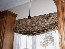 Avanti Shaped Bottom Roman Shade with Trim