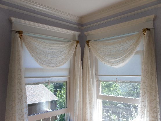 Sheer Swags and Panels with Decorative Brackets