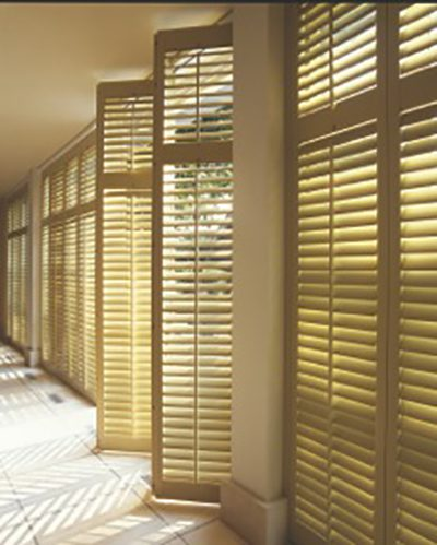 Woodlore™ Shutter in a Bay Window with Standard Tilt Louvers