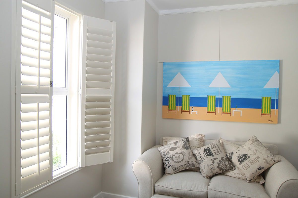 Woodlore™ Composite Wood Shutters in Family Room