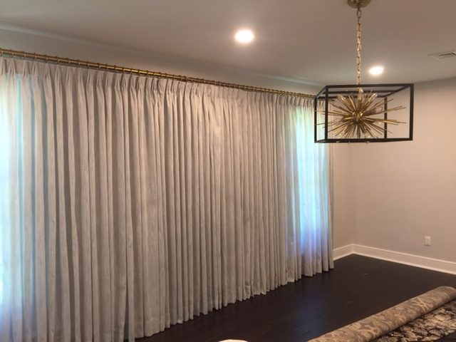 Fan Pleated Draperies Mounted on Pole with Rings in Dining Room