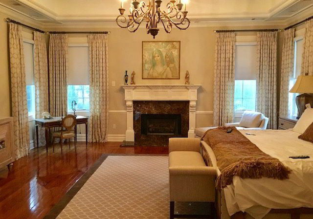 Pinch Pleat Drapes on Rods with Crystal Finials in Master Bedroom