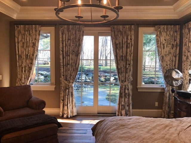 Pinch Pleat Drapes with Tie Backs in Master Bedroom