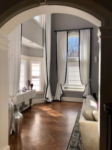 Pleated Draperies in High Window in Living Room